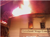 Fire blazing out of roof of Loveland Stage Company building