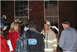 Fire fighter surrounded by reporters being interviewed