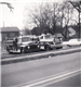 Black and white photo of two fire department trucks