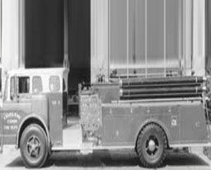 Black and white photo of motorized fire engine
