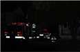 Fire truck and fire fighter reflective materials showing in the dark of the night