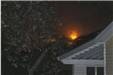 View of fire above neighboring roof