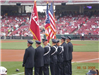 Side view of Honor Guard members holding flags
