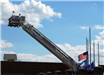 Fire truck ladder raised at memorial event