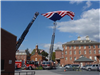 Flag flying between two fire trucks