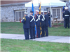 Guard members prepare to present the colors
