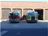 Loveland and Gettysburg fire trucks in front of fire station doors
