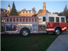 Side view of memorial fire truck with paintings on side
