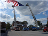 American flag raised between Loveland-Symmes fire truck and blue fire truck