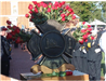 Fallen firefighter memorial with roses behind and in font of statue