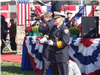 Fire fighter holding memorial flag
