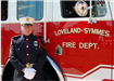 Fire fighter poses in front of Loveland-Symmes Fire Department truck