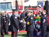 Fire fighter presenting memorial flag