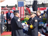 Fire fighter presents memorial flag for fallen fire fighter
