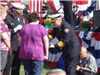 Fire fighter presents women with memorial flag