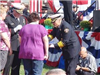 Chief Huber - Presenting a flag to a woman at the National Fallen Firefighters Memorial in 2009