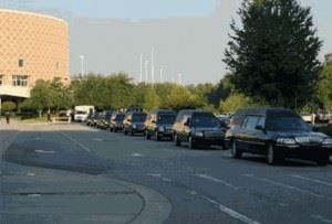 Cars lined up for beginning of memorial procession on June 22, 2007