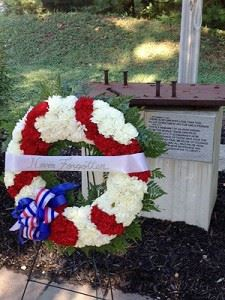 Red and white wreath at September 11 Memorial